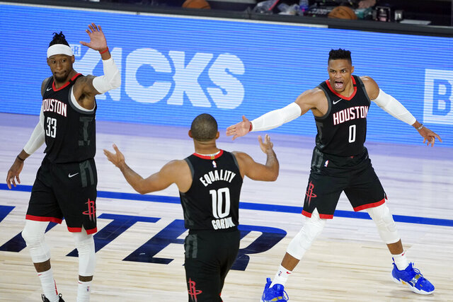 Houston Rockets' Russell Westbrook (0), Eric Gordon (10) and Robert Covington celebrate during the second half of an NBA basketball first round playoff game against the Oklahoma City Thunder Saturday, Aug. 29, 2020, in Lake Buena Vista, Fla. (AP Photo/Ashley Landis)