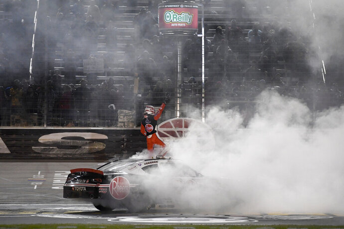 Christopher Bell stands on his car celebrating his win in the NASCAR Xfinity Series auto race at Texas Motor Speedway in Fort Worth, Texas, Saturday, Nov. 2, 2019. (AP Photo/Larry Papke)