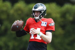 Philadelphia Eagles quarterback Carson Wentz looks to pass at the NFL football team's practice facility in Philadelphia, Wednesday, Sept. 4, 2019. (AP Photo/Matt Rourke)