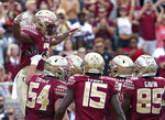 Florida State's Cam Akers is lifted by his teammates in celebration after scoring a touchdown against Wake Forest in the first quarter of an NCAA college football game, Saturday, Oct. 20, 2018 in Tallahassee, Fla. (AP Photo/Steve Cannon)