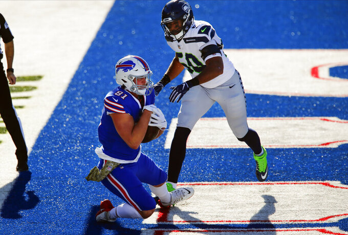 Buffalo Bills tight end Tyler Kroft (81) catches a pass for a touchdown in front of Seattle Seahawks' K.J. Wright (50) during the first half of an NFL football game Sunday, Nov. 8, 2020, in Orchard Park, N.Y. (AP Photo/John Munson)