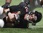 Atlanta Falcons quarterback Matt Ryan grimaces as he hits the ground on one of nine sacks by the New Orleans Saints, during the second half of NFL football game Thursday, Nov. 28, 2019, in Atlanta. (Curtis Compton/Atlanta Journal-Constitution via AP)