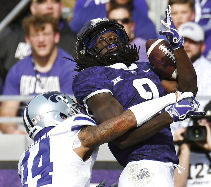 Kansas State's Kevion McGee, left, breaks up a pass intended for TCU's Tevailance Hunt during the second quarter of an NCAA college football game Saturday, Nov. 3, 2018, in Fort Worth, Texas. (Bob Haynes/Star-Telegram via AP)