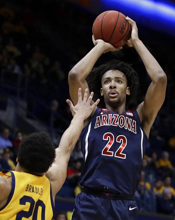 Arizona's Zeke Nnaji, right, shoots over California's Matt Bradley (20) in the first half of an NCAA college basketball game Thursday, Feb. 13, 2020, in Berkeley, Calif. (AP Photo/Ben Margot)