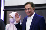 "Malaysia's opposition leader Anwar Ibrahim waves after a press conference in Kuala Lumpur, Wednesday, Sept. 23, 2020. Anwar said he has secured a majority in parliament to form a new government that is ""strong, stable and formidable."