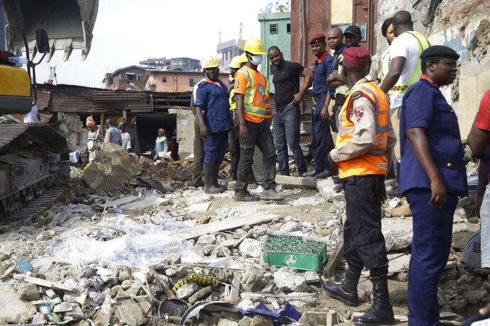 Emergency workers attend the scene after a building collapsed in Lagos, Nigeria, Thursday March 14, 2019. Search and rescue work continues in Nigeria a day after a building containing a school collapsed with scores of children said to be inside. A National Emergency Management Agency spokesman late Wednesday said 37 people had been pulled out alive, with eight bodies recovered from the ruins.(AP Photo/Sunday Alamba)
