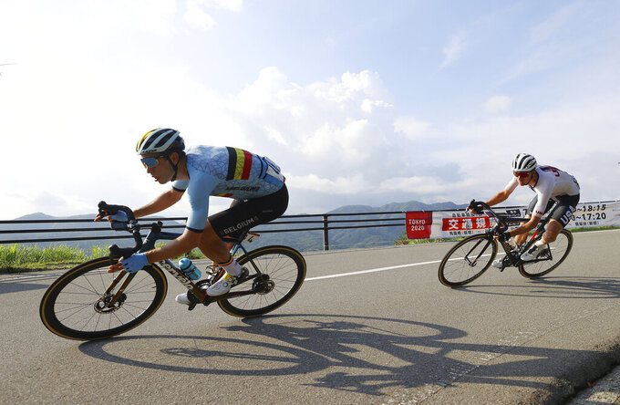 Wout van Aert of Belgium, left, and Brandon McNulty of the United States compete in the men's cycling road race at the 2020 Summer Olympics, Saturday, July 24, 2021, in Oyama, Japan. (Tim de Waele/Pool Photo via AP)