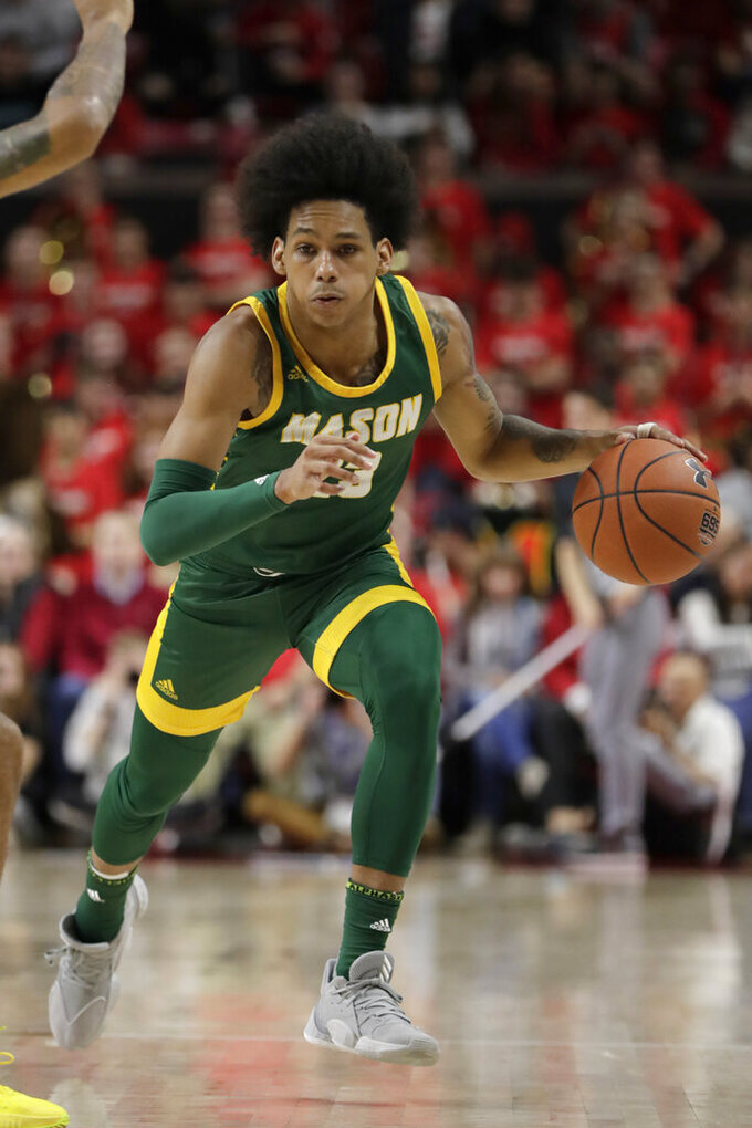 George Mason guard Javon Greene drives to the basket during the first half of the team's NCAA college basketball game against Maryland on Friday, Nov. 22, 2019, in College Park, Md. (AP Photo/Julio Cortez)