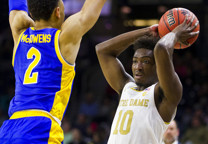 Notre Dame's Temple 'T.J.' Gibbs (10) gets pressure from Pittsburgh's Trey McGowens (2) during the first half of an NCAA college basketball game Wednesday, Feb. 5, 2020, in South Bend, Ind. (AP Photo/Robert Franklin)