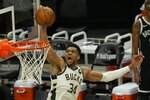 Milwaukee Bucks' Giannis Antetokounmpo dunks during the second half of Game 4 of the NBA Eastern Conference basketball semifinals game against the Brooklyn Nets Sunday, June 13, 2021, in Milwaukee. (AP Photo/Morry Gash)