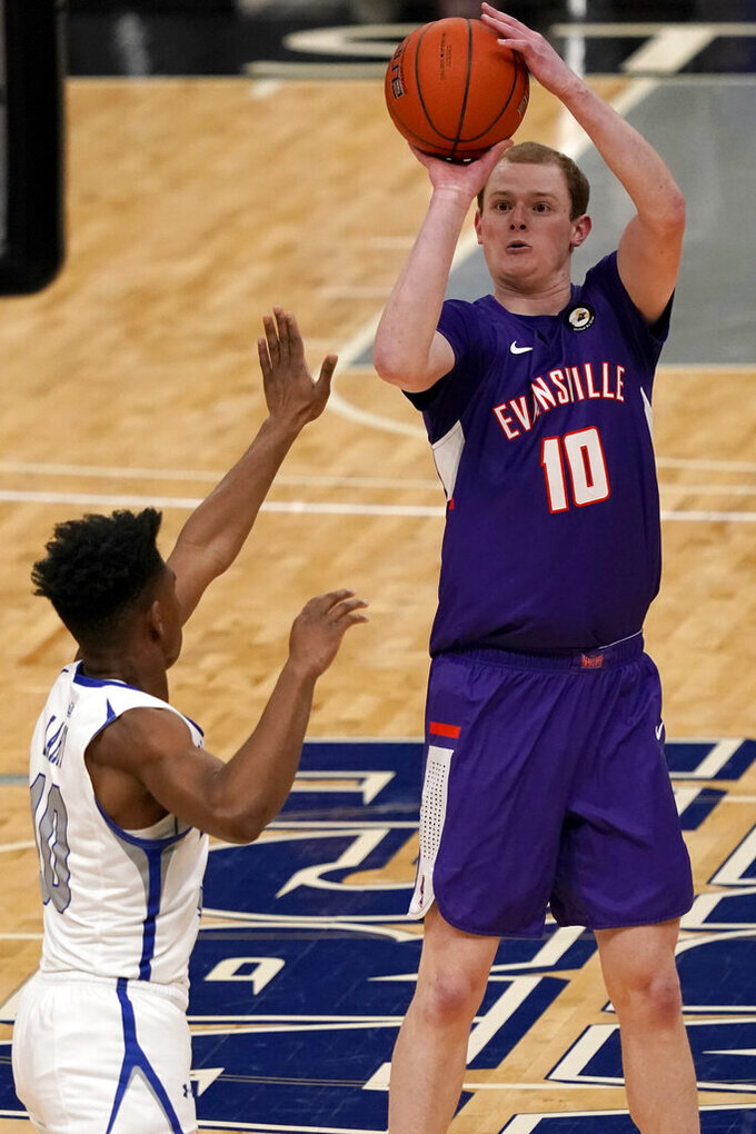 Evansville's Evan Kuhlman, right, shoots over Indiana State's Julian Larry during the first half of an NCAA college basketball game in the quarterfinal round of the Missouri Valley Conference men's tournament Friday, March 5, 2021, in St. Louis. (AP Photo/Jeff Roberson)