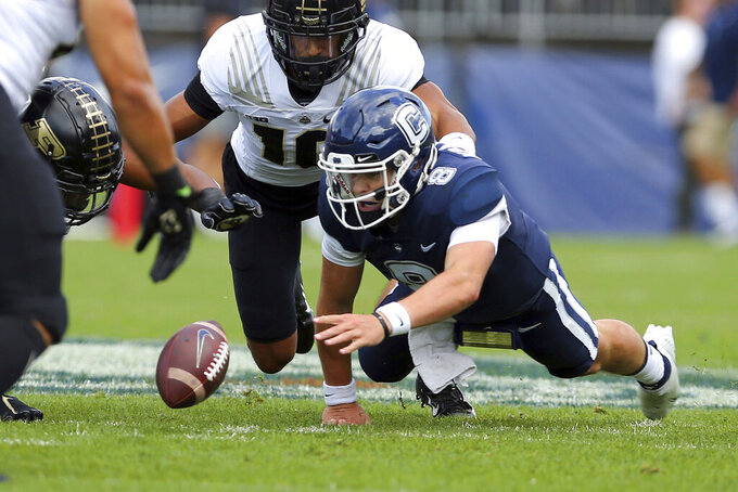 Connecticut quarterback Steven Krajewski (8) looks to recover a fumble during the first half of an NCAA football game against Purdue on Saturday, Sept. 11, 2021, in East Hartford, Conn. (AP Photo/Stew Milne)