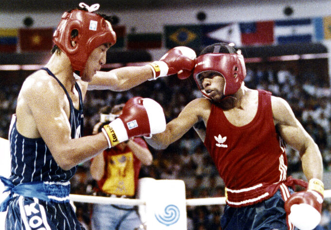 FILE - In this Oct. 2, 1988, file photo, South Korea's Park Si-hun, left, delivers a left jab to America's Roy Jones, and goes on to win the gold medal in the gold medal bout of the light middleweight division at the summer Olympics in Seoul, South Korea. (AP Photo/Ron Kutz, File)