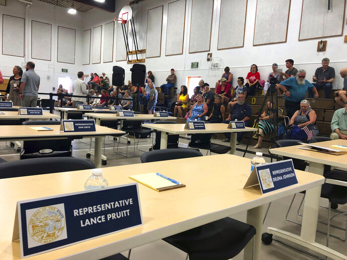 Spectators fill bleachers inside the Wasilla Middle School gym ahead of a legislative meeting Monday, July 8, 2019 in Wasilla, Alaska. In a rare move, nearly a third of Alaska lawmakers are expected to buck their leadership in both chambers and meet Monday in Wasilla even though a majority of lawmakers will convene the special session in Juneau, the state capital, about 600 miles away. (AP Photo/Mark Thiessen)