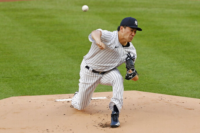 New York Yankees starting pitcher Masahiro Tanaka delivers during the first inning of a baseball game against the Atlanta Braves, Wednesday, Aug. 12, 2020, in New York. (AP Photo/Kathy Willens)
