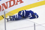 Toronto Maple Leafs defenceman Tyson Barrie (94) lies on the ice during the second period of an NHL Eastern Conference Stanley Cup playoff game in Toronto on Sunday, Aug. 9, 2020. (Nathan Denette/The Canadian Press via AP)
