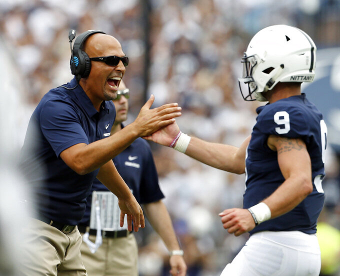 FILE - In this Sept. 1, 2018, file photo, Penn State head coach James Franklin, left, congratulates quarterback Trace McSorley (9) after scoring against Appalachian State during the first half of an NCAA college football game in State College, Pa. Penn State plays Pitt at Heinz Field on Saturday and it will be the 99th in a series that dates back to 1893. It's also the last in Pittsburgh for the foreseeable future between the Panthers (1-0) and the Nittany Lions (1-0). There are no plans for the teams to play past next year's centennial showdown at Beaver Stadium, a byproduct of the tricky scheduling of big-time college football. (AP Photo/Chris Knight, File)