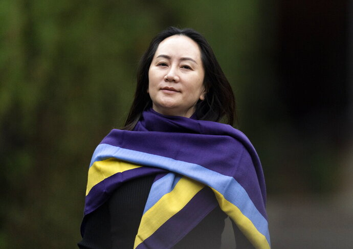 Chief Financial Officer of Huawei, Meng Wanzhou leaves her home in Vancouver, Wednesday, Oct. 28, 2020. Wanzhou is heading to the British Columbia Supreme Court in an evidentiary hearing on her extradition case on abuse of process argument.  (Jonathan Hayward/The Canadian Press via AP)