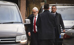 Labour Leader Jeremy Corbyn leaves Islington Town Hall after an interview regarding the results of the General Election, in London, Friday, Dec. 13, 2019. Jeremy Corbyn says an internal election to choose a new leader to replace him will happen early next year. (AP Photo/Alberto Pezzali)