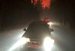 In this Nov. 8, 2018, photo shows vehicles crowded onto a street in Paradise, Calif., fleeing the Camp Fire. The scale of disaster in the Camp Fire was unprecedented, but the scene of people fleeing wildfire was familiar, repeated numerous times over the past three years up and down California from Redding and Paradise to Santa Rosa, Ventura and Malibu. In many of those communities, motorists became stuck in traffic as officials tried to evacuate thousands onto a few roads leading away from the flames. (Darrel Wilken via AP)