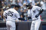 New York Yankees' Didi Gregorius celebrates hitting a home run with Gleyber Torres during the fourth inning of a baseball game against the Cleveland Indians, Saturday, Aug. 17, 2019, in New York. (AP Photo/Mary Altaffer)