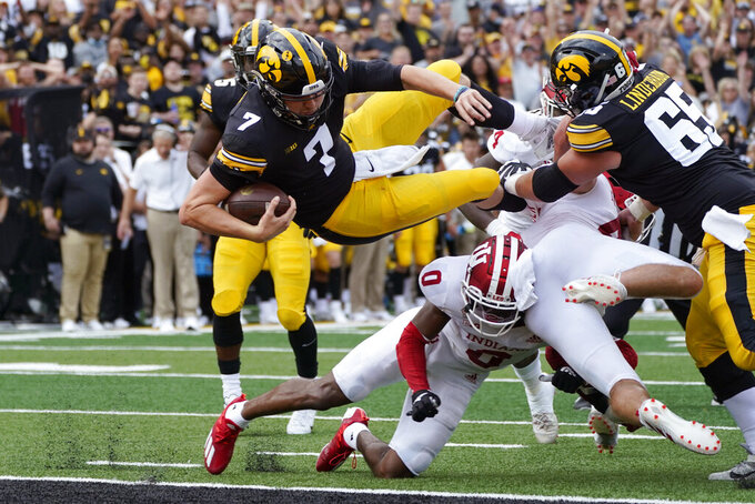Iowa quarterback Spencer Petras (7) scores on a 9-yard touchdown run during the first half of an NCAA college football game against Indiana, Saturday, Sept. 4, 2021, in Iowa City, Iowa. (AP Photo/Charlie Neibergall)