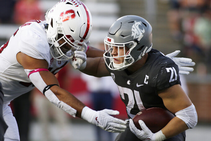 Washington State running back Max Borghi, right, carries the ball while pressured by Stanford linebacker Stephen Herron during the first half of an NCAA college football game Saturday, Oct. 16, 2021, in Pullman, Wash. (AP Photo/Young Kwak)