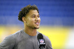 FILE - North Dakota State quarterback Trey Lance smiles as he is interviewed at the school's football NFL Pro Day in Fargo, N.D., in this Friday, March, 12, 2021, file photo. Lance will likely be one of the first two players drafted from non-Football Bowl Subdivision programs next week. (AP Photo/Andy Clayton- King, File)