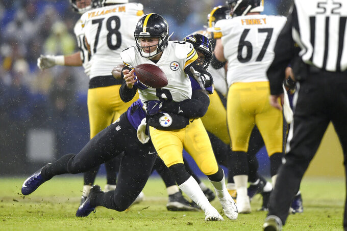 Pittsburgh Steelers quarterback Devlin Hodges (6) fumbles the ball during a strip sack by Baltimore Ravens outside linebacker Matt Judon during the first half of an NFL football game, Sunday, Dec. 29, 2019, in Baltimore. (AP Photo/Gail Burton)
