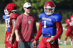 FILE - In this Monday, Aug. 5, 2019 file photo, Oklahoma head coach Lincoln Riley watches quarterback Jalen Hurts (1) during an NCAA college football practice in Norman, Okla. Oklahoma quarterback Jalen Hurts is cramming as he prepares for his only year with the Sooners. Before transferring from Alabama, he played in three national title games. (AP Photo/Sue Ogrocki, File)