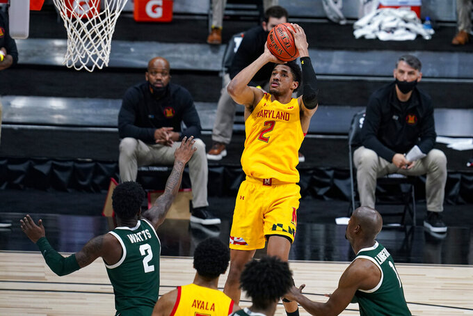 Maryland guard Aaron Wiggins (2) shoots against Michigan State in the second half of an NCAA college basketball game at the Big Ten Conference tournament in Indianapolis, Thursday, March 11, 2021. Maryland defeated Michigan State 68-57. (AP Photo/Michael Conroy)