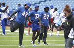 Buffalo Bills safety Siran Neal (33), Buffalo Bills linebacker Tremaine Edmunds (49) and Buffalo Bills cornerback Tre'Davious White (27) stretch during warm ups at practice at Bills Stadium in Orchard Park, N.Y. Wednesday, Sept. 2, 2020. (James P. McCoy /The Buffalo News via AP, Pool)