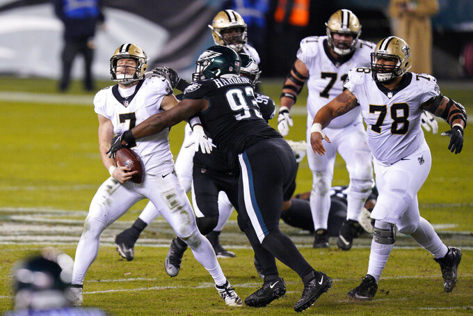 New Orleans Saints' Taysom Hill (7) is sacked by Philadelphia Eagles' Javon Hargrave (93) during the second half of an NFL football game, Sunday, Dec. 13, 2020, in Philadelphia. (AP Photo/Chris Szagola)