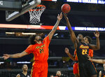 Minnesota's Jordan Murphy (21) fights for a rebound with College of Charleston's Jarrell Brantley (22) during the College All-Star Game at the Final Four NCAA college basketball tournament, Friday, April 5, 2019, in Minneapolis. (AP Photo/Jeff Roberson)