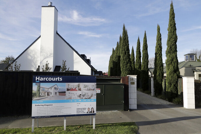 FILE - In this Aug. 13, 2018, file photo a house is pictured for sale in Christchurch, New Zealand. New Zealand will spend billions of dollars to encourage more home building and will also remove some tax breaks for speculators as it tries to slow skyrocketing house prices. The government on Tuesday announced a series of new measures to address what Prime Minister Jacinda Ardern is describing as a crisis.(AP Photo/Mark Baker, File)