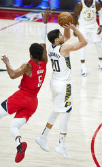 Indiana Pacers forward Doug McDermott, right, shoots a three-point basket in front of Portland Trail Blazers guard Rodney Hood during the first half of an NBA basketball game in Portland, Ore., Thursday, Jan. 14, 2021. (AP Photo/Craig Mitchelldyer)