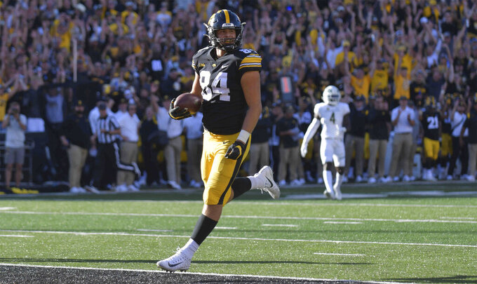 Iowa tight end Sam LaPorta (84) scores a touchdown during the second half of an NCAA college football game against Colorado State, Saturday, Sept. 25, 2021, in Iowa City, Iowa. (AP Photo/Ron Johnson)