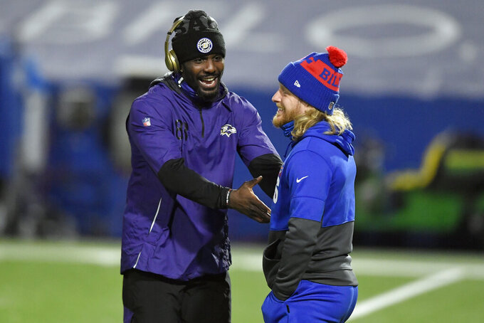 Baltimore Ravens' Dez Bryant, left, talks to Buffalo Bills' Cole Beasley before an NFL divisional round football game Saturday, Jan. 16, 2021, in Orchard Park, N.Y. (AP Photo/Adrian Kraus)