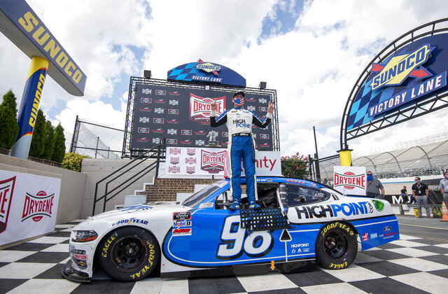 Chase Briscoe (98) celebrates after winning a NASCAR Xfinity Series auto race at Dover International Speedway, Sunday, Aug. 23, 2020, in Dover, Del. (AP Photo/Jason Minto)
