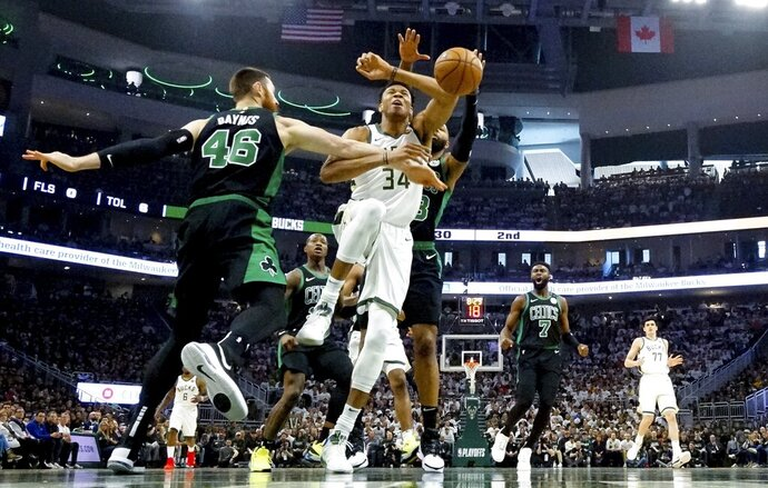 Milwaukee Bucks' Giannis Antetokounmpo is fouled during the first half of Game 1 of a second round NBA basketball playoff series against the Boston Celtics Sunday, April 28, 2019, in Milwaukee. (AP Photo/Morry Gash