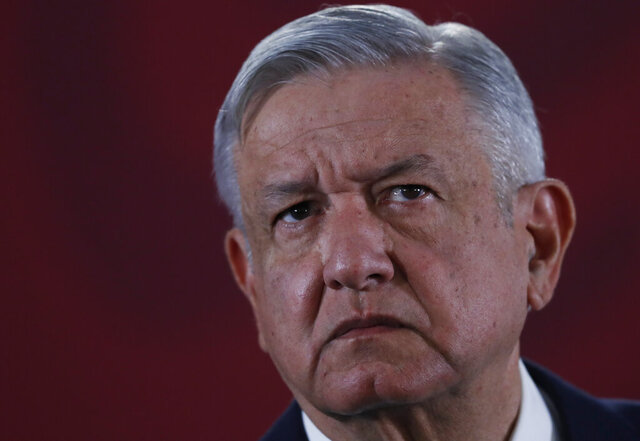 "FILE - In this Nov. 29, 2019 file photo, Mexican President Andres Manuel Lopez Obrador listens to questions during his daily morning press conference at the National Palace in Mexico City. Shortly before taking office Lopez Obrador decided to create an army of volunteers dubbed the ""servants of the nation,"" to canvass people who receive government benefits collecting their personal information in part to see if they might be eligible for yet more help from various programs promised during the campaign for the likes of farmers, the disabled, unemployed youth and the elderly. The effort alarmed opposition political parties who saw it as an attempt to illegally use public funds to promote López Obrador and his leftist Morena party.  (AP Photo/Marco Ugarte, File)"