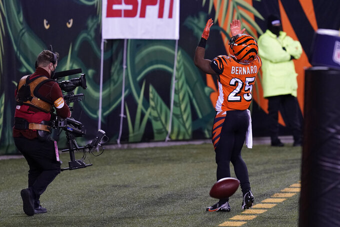 Cincinnati Bengals' Giovani Bernard (25) celebrates a touchdown reception during the first half of an NFL football game against the Pittsburgh Steelers, Monday, Dec. 21, 2020, in Cincinnati. (AP Photo/Michael Conroy)