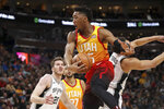 Utah Jazz guard Donovan Mitchell (45) grabs a rebound with one hand before San Antonio Spurs guard Bryn Forbes (11) could reach it during the first quarter of an NBA basketball game, Saturday, Feb. 9, 2019, in Salt Lake City. (AP Photo/Chris Nicoll)