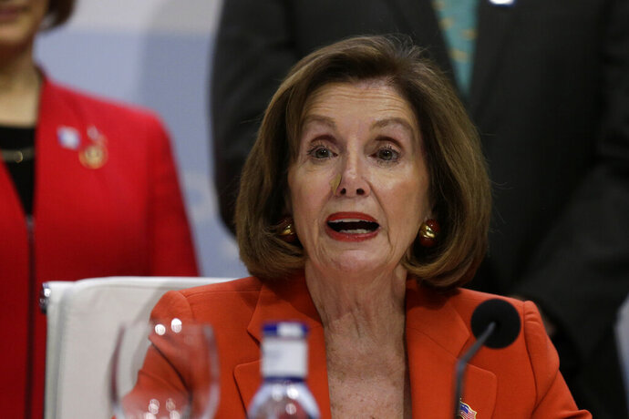 House Speaker Nancy Pelosi of Calif. speaks during a press conference at the COP25 climate talks summit in Madrid, Monday Dec. 2, 2019. The chair of a two-week climate summit attended by nearly 200 countries warned at its opening Monday that those refusing to adjust to the planet's rising temperatures