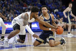 George Washington's Jameer Nelson Jr., right, and Saint Louis' Hasahn French battle vie for a loose ball during the first half of an NCAA college basketball game Wednesday, Jan. 8, 2020, in St. Louis. (AP Photo/Jeff Roberson)