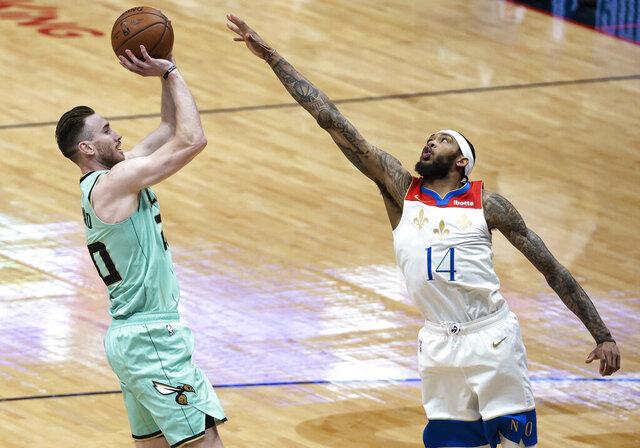 Charlotte Hornets forward Gordon Hayward (20) shoots over New Orleans Pelicans forward Brandon Ingram (14) during the first quarter of an NBA basketball game in New Orleans, Friday, Jan. 8, 2021. (AP Photo/Derick Hingle)