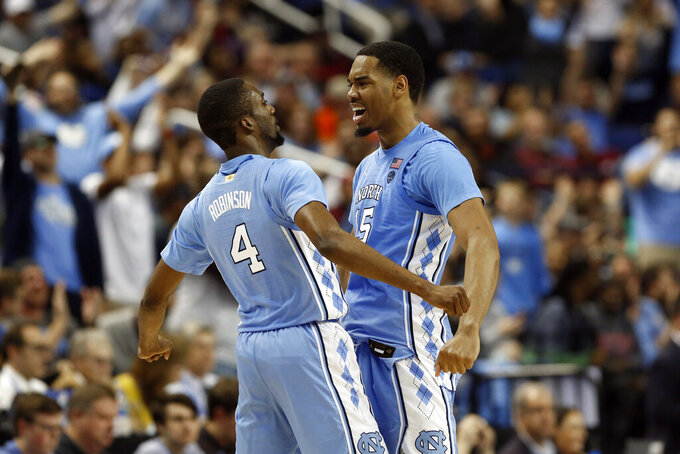 North Carolina guard Brandon Robinson (4) and forward Garrison Brooks (15) react during the second half of an NCAA college basketball game against Virginia Tech at the Atlantic Coast Conference tournament in Greensboro, N.C., Tuesday, March 10, 2020. (AP Photo/Ben McKeown)