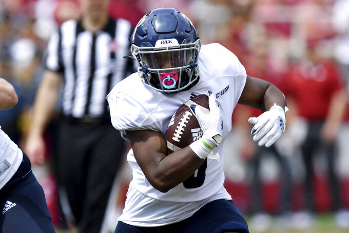 Rice running back Khalan Griffin (6) runs the ball against Arkansas during the first half of an NCAA college football game Saturday, Sept. 4, 2021, in Fayetteville, Ark. (AP Photo/Michael Woods)
