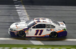 Denny Hamlin (11) crosses the finish line to win a NASCAR Daytona 500 auto race at Daytona International Speedway, Sunday, Feb. 17, 2019, in Daytona Beach, Fla. (AP Photo/John Raoux)