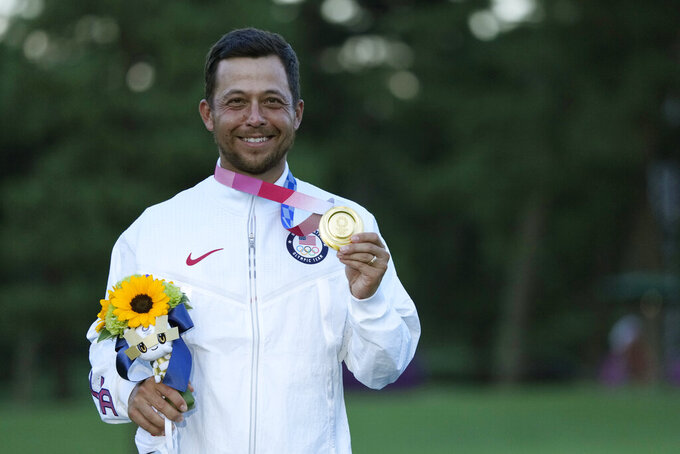 Xander Schauffele, of the United States, holds his gold medal in the men's golf at the 2020 Summer Olympics on Sunday, Aug. 1, 2021, in Kawagoe, Japan. (AP Photo/Andy Wong)